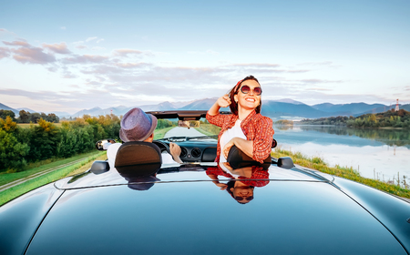 Photo pour Couple in love ride in cabriolet on the picturesque mountain road - image libre de droit
