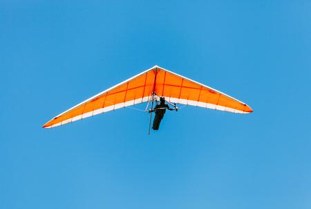 Photo pour Soaring hang gliding in the sky - image libre de droit