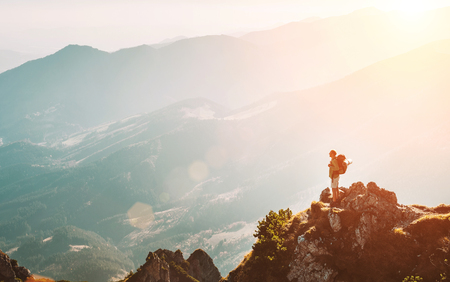 Photo pour Mountain hiker with backpack tiny figurine stay on mountain peak with breathtaking hills panorama - image libre de droit