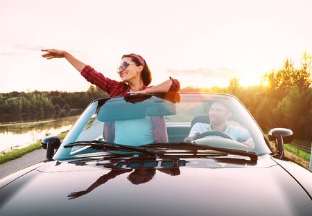 Photo pour Couple in love traveling by cabriolet - image libre de droit