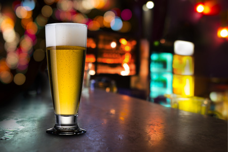 Photo pour Glass of Beer In Pub - image libre de droit