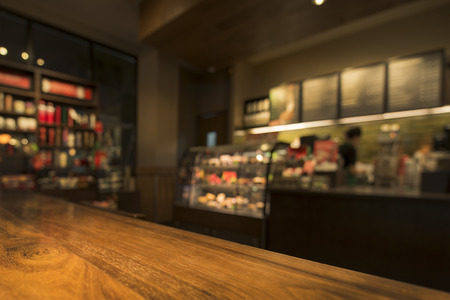 Photo pour Wood Table With Coffee Shop View In Background - image libre de droit