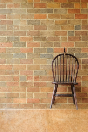 Red brick wall and chair on the wall の写真素材