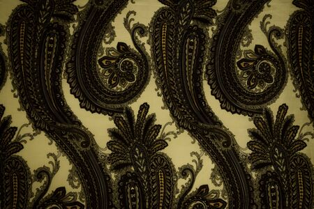 Vintage faded paisley fabric texture