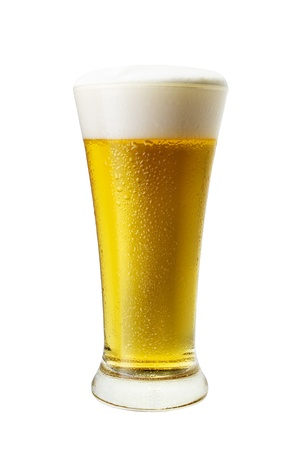 Glass of cool light beer close-up with froth isolated on a white background