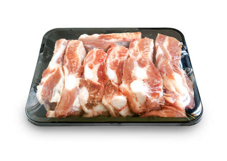 Foto für Isolated organic spare ribs in black tray container, plastic film wrapped, white background. Soft part of pork spare ribs. Fresh raw spare ribs arranged in small tray for sell. - Lizenzfreies Bild