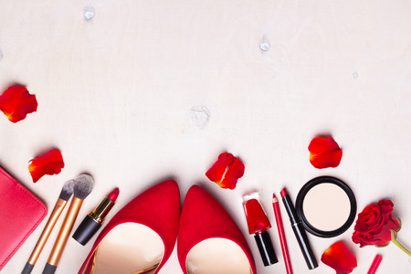 Beauty cosmetic white background. Makeup essentials. Shoes, red lipstick, powder, brushes set. Cosmetic products. Top view. Feminine or fashion background. Cosmetics. Beauty products. Modern woman