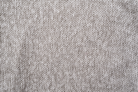 Photo pour Texture of a gray wool knitted sweater. Close-up. Seamless - image libre de droit