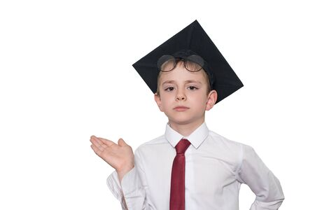 Photo pour Boy in a square academic hat and glasses holds his palm up. School concept. Isolate - image libre de droit