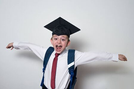 Photo pour Happy cheerful schoolboy in graduate hat. Passed the exams. Junior High School. - image libre de droit