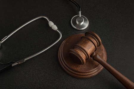 Photo for Gavel hammer of judge and stethoscop on black background. Sentence on medical negligence - Royalty Free Image