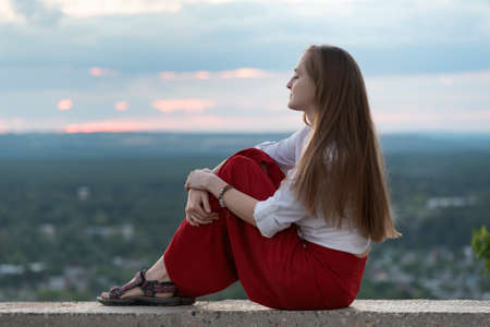 Photo pour Portrait of young woman with long hair on hill background. Calm and serenity. - image libre de droit