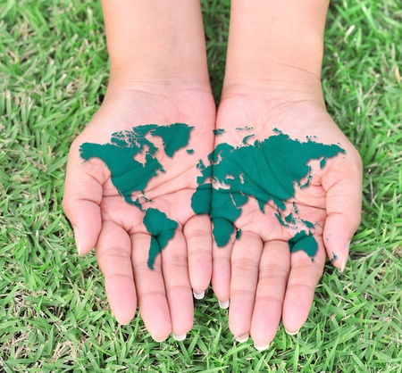 The open hands of World map.