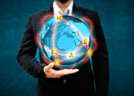 Businessman holding world .Technology conceptの写真素材
