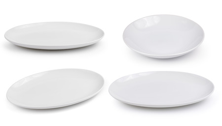 empty white plates on a white background