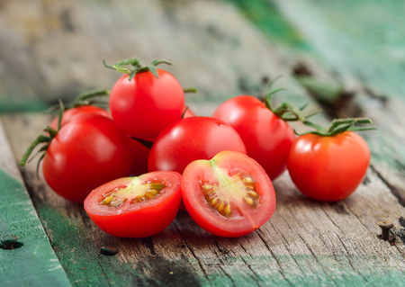 Close-up of fresh, ripe cherry tomatoes on wood