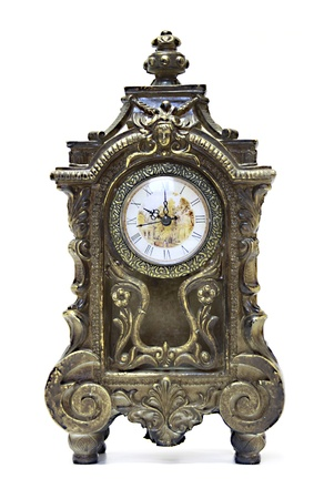 An antique clock ornate with floral motives