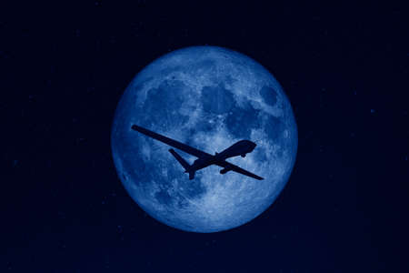 Photo for Silhouette of unmanned aerial vehicle (UAV) flying against background of huge full moon in dark starry space. - Royalty Free Image