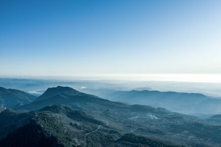 Photo pour An aerial view of the forest and mountains with an open sky. - image libre de droit