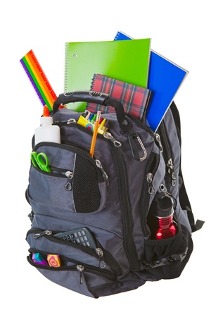 Backpack full of school supplies.  Shot on white background.