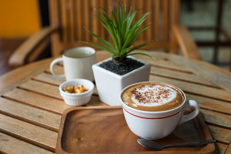 Photo pour Hot capuchino Coffee in white cup on wooden table - image libre de droit