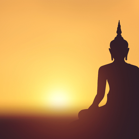Buddha statue on sunset background