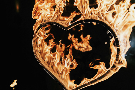 Foto de heart shaped firework on black background, fire show in night. happy valentine's day card. bengal fire burning heart. space for text. wedding or valentine concept. happy new year - Imagen libre de derechos