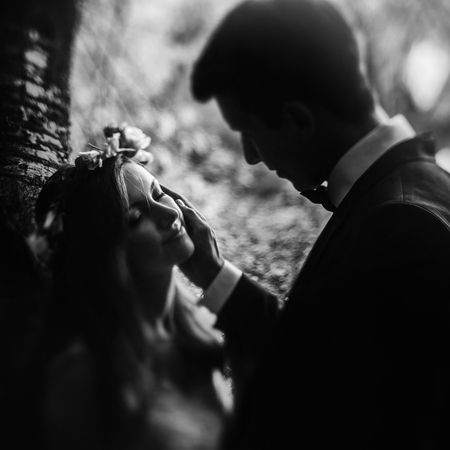 Photo for amazing sensual boho bride and stylish elegant groom, gentle touch in sunny woods - Royalty Free Image