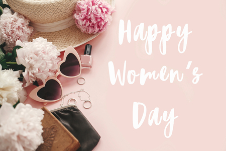 Foto de Happy Women's Day text sign at stylish girly pink retro sunglasses,peonies, jewelry, hat, purse,cosmetics on pastel pink paper flat lay. Girl Power. International womens day, 8 march - Imagen libre de derechos
