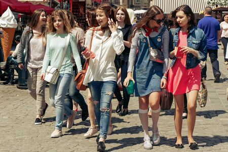 Photo pour many young happy women walking talking  on background of old european city street, stylish hipster girls having fun, moments of happiness, friendship concept - image libre de droit