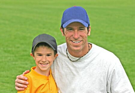 Father and Son Wearing Baseball Hats