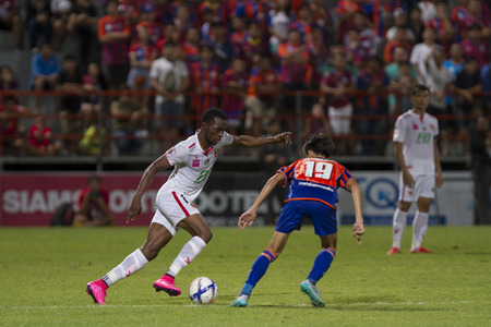 BANGKOK,THAILAND:AUGUST;2015:Gilbert Koomson of BEC-Tero and Siwakon Chakkhuprasat of Port fc poses during football Thai Premier League between between PORT FC and BEC-Tero sasana at PAT Stadium on AUGUST 9,2015inThailand.