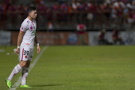 BANGKOK,THAILAND:AUGUST;2015:Tristan Somchai Do of BEC-Tero poses during football Thai Premier League between between PORT FC and BEC-Tero sasana at PAT Stadium on AUGUST 9,2015inThailand.