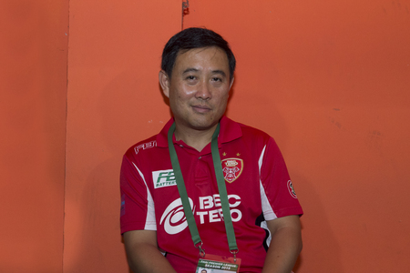 BANGKOK,THAILAND:AUGUST;2015:Thanya Vongnark ThailandTeam manager of BEC-Teroi n football Thai Premier League between between PORT FC and BEC-Tero sasana at PAT Stadium on AUGUST 9,2015inThailand.