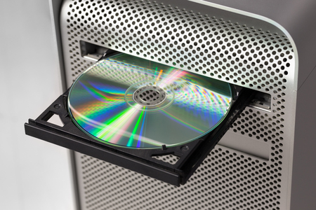 DVD CD ROM on a computer opened to show disc. Top view