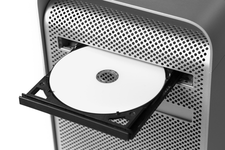 Inserting a white CD / DVD into a computer. Top view