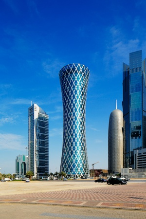 The hyperbolic shape of the tower is intended to represent a desert whirlwind, hence the name  Tornado Tower  It is located in West Bay Doha close to the Cornishe and stands 200m tall