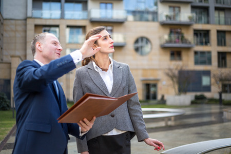 Real estate agent presenting new apartment