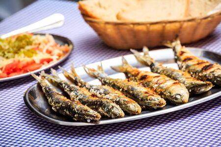 Foto de Grilled sardines with salad, bread and potato, Portugal - Imagen libre de derechos