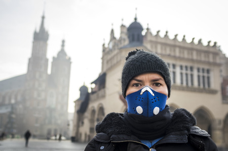 Woman using a mask, protecting herself from smog, Krakow, Poland