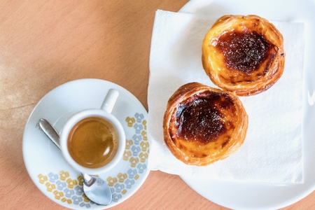 Traditional Portuguese pastry called pastel de nata and coffee