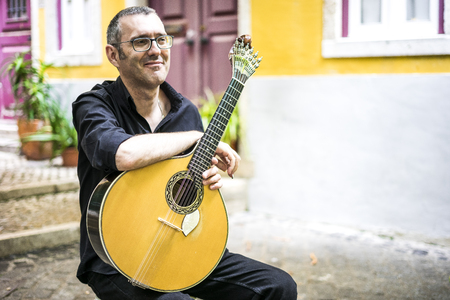 Musician with his beloved  portuguese guitar on the street of Lisbon, Portugal