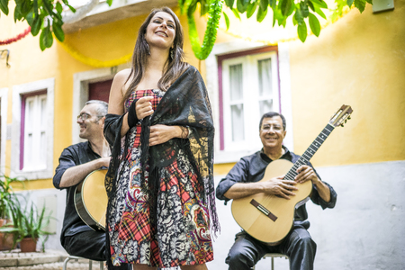 Fado band performing traditional portuguese music in the courtyard of Alfama, Lisbon, Portugal