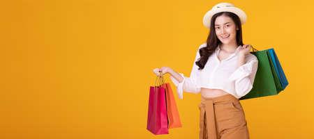 Photo pour Happy asian woman holding shopping bag with mid year sale. - image libre de droit