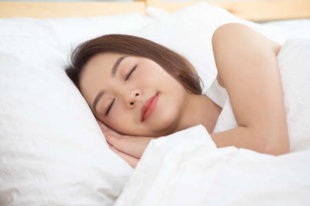 Photo for Asian women sleeping and sweet dream on white bed in bedroom. - Royalty Free Image