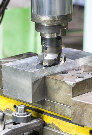 operator cutting steel surface by milling machine and milling holder