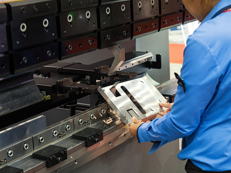 operator bending metal sheet by sheet bending machine, cnc control metal sheet bending machine, high precision and high accuracy metal sheet bending machine