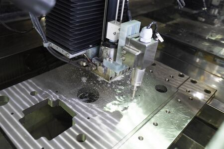 Foto de CNC wire cut machine cutting high precision mold parts - Imagen libre de derechos