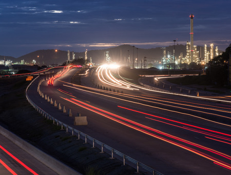 Photo pour Beautiful lighting of oil refinery plant petrochemical industry with transport - image libre de droit
