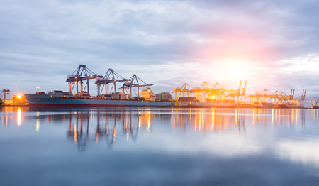 Photo pour Containers loading Shipping by crane at morning or Trade Port - image libre de droit